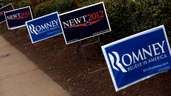 Spuren eines langen Kampfes: Werbeschilder von Newt Gingrich und Mitt Romney.