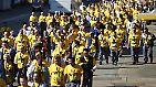 Zur Rede der Kanzlerin rückt die Belegschaft in gelben T-Shirts an.