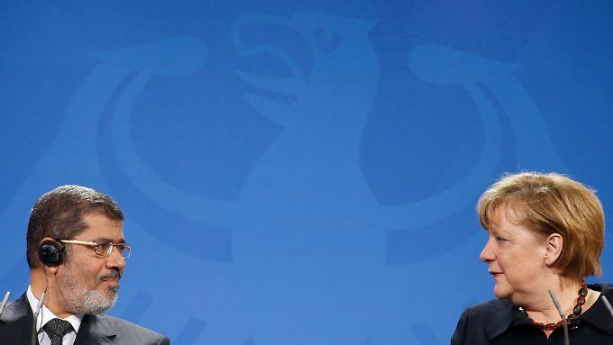Mursi und Merkel: Realpolitik.
