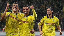 Verschworene Gemeinschaft? Dortmunds Nuri Sahin, links, war schon weg. Mario Götze geht zum FC Bayern. Und was ist mit Robert Lewandowski, rechts?
