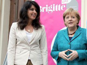 """Ohne Raute geht es nicht: Kanzlerin Merkel und """"Brigitte""""-Chefredakteurin Huber."""