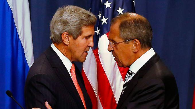 Kerry (l) und Lawrow zeigen sich in Genf einig.