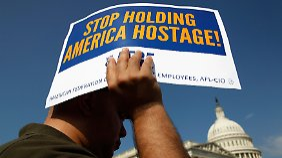 Einstimmiger Beschluss in Washington: Zwangsbeurlaubte werden bezahlt