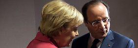 Merkel mit Hollande: lieber unter vier Augen sprechen.
