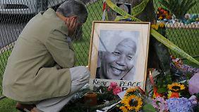 """""""Er war wie eine Vaterfigur"""": Südafrikaner trauern um Nelson Mandela"""