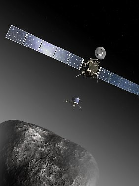 Computer Illustration: The Philae lander (M) on his flight from the space probe Rosetta (above) to the comet 67P/Churyumov-Gerasimenko.