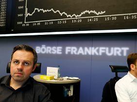 Ernste Gesichter an der Frankfurter Börse: Der VDax steigt, die Kurse fallen.