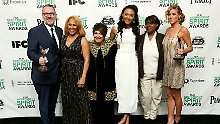 "Director/producer Morgan Neville (L), singer Darlene Love (2nd L), singer Judith Hill (3rd R), producer Caitrin Rogers (R) and other cast members from ""20 Feet From Stardom"" pose with their Best Documentary award backstage at the 2014 Film Independent Spirit Awards in Santa Monica"