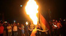 ... an anderen Orten der Welt zelebrierte Fans den Sieg der deutschen Elf. In Libanons Haupstadt Beirut, ...