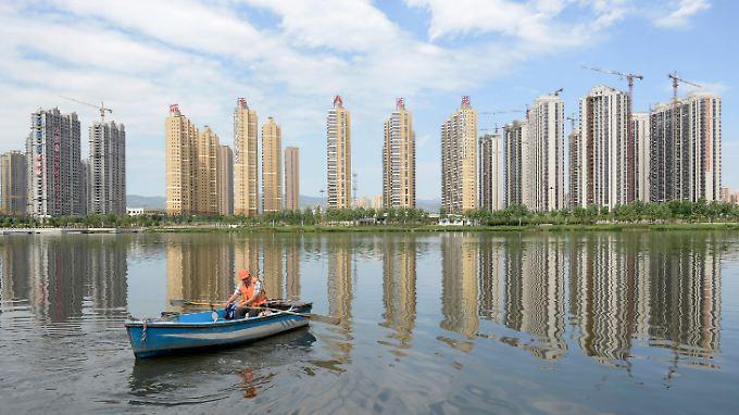 Bauboom in chinesischen Maßstäben: Am Rande der großen Metropolen schießen Wohntürme aus dem Boden.