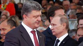 Drohte Putin (r.) Poroschenko (l.)? Der Kreml sagt nein.