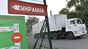 Noch ist strittig: Transportieren die Laster nur humanitäre Güter?
