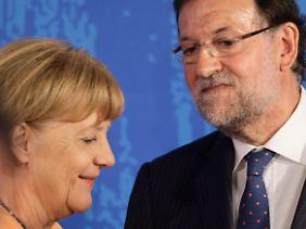 Merkel und Mariano Rajoy wollen einen spanischen Eurogruppen-Chef.