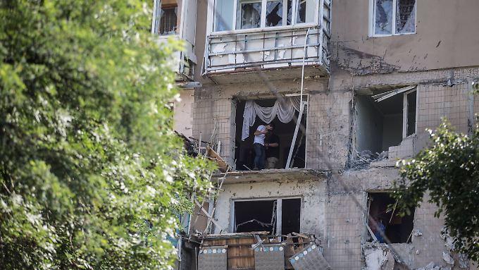 Zerstörte Häuser in Donezk: Ein Ende des Kriegs in der Ostukraine ist nicht in Sicht.