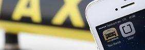 Streit mit dem Taxigewerbe: Nun will Uber seinen Smartphone-Dienst UberPop mit privaten Fahrern zu einer Art Mitfahrzentrale zu machen. Foto: Jörg Carstensen