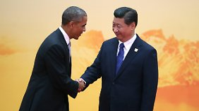 Freundliches Händeschütteln von US-Präsident Obama Chinas Präsident Xi für die Presse in Peking. Im Pazifikraum konkurrieren die USA und China um Macht und Einfluss.