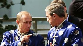 Noch einträchtig im Partner-Look: Putin und Bush im Jahr 2001.