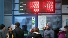 Im Schwitzkasten Russlands: Weißrussland gerät in Rubel-Panik