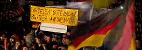Bewegung singt Weihnachtslieder: EKD-Vorsitzender will mit Pegida reden