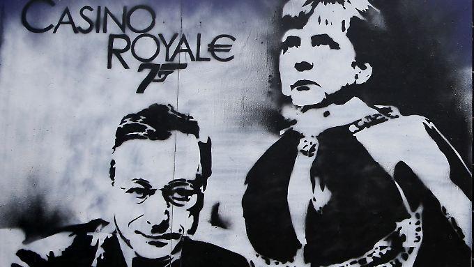Ein Graffity mit den Konterfeis von EZB-Chef Draghi und Bundeskanzlerin Merkel. Deutschland ist vehement gegen eine Vergemeinschaftung der Risiken in der Eurozone.
