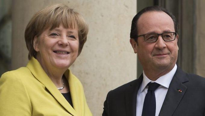 Bundeskanzlerin Merkel und Frankreichs Staatschef Hollande wollen Athen im Euro halten.