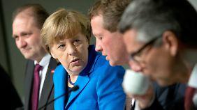 Wirtschaft formuliert Ärgernisliste: Merkel vertröstet deutsche Unternehmen
