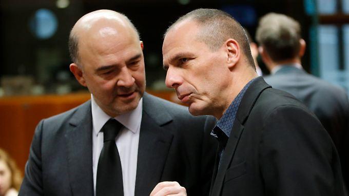 Pierre Moscovici (l.) und Griechenlands Finanzminister Yanis Varoufakis: Keiner der beiden Politiker will eigentlich, dass Griechenland aus der Eurozone fliegt.