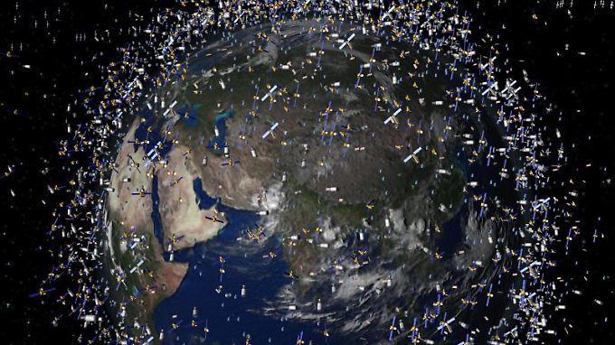 Die Müllwolke rund um unseren Planeten: Die Computergrafik der ESA zeigt Weltraummüll früherer Weltraummissionen, der neben intakten Satelliten um die Erde kreist.