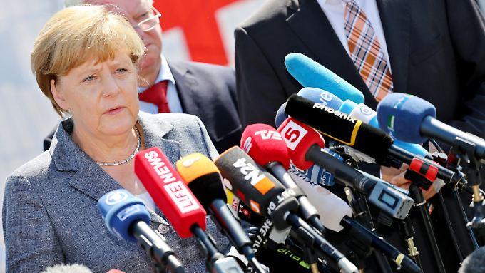 Mit den Demonstranten sprach die Kanzlerin nicht - es wäre vermutlich auch ein einseitiges Gespräch geworden.