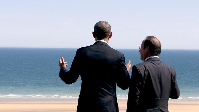 """""""Wir kaufen mehr"""": US-Präsident Obama (l.) führt nun auch Deutschlands größten Absatzmarkt. Hollandes Frankreich ist zweitwichtigster Handelspartner."""