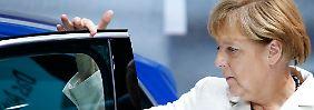 Einseitig auf den Automobilbau ausgerichtet? Bundeskanzlerin Merkel am VW-Stand auf der IAA.