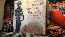 Das Auktionshaus Julien's hatte sich eigentlich einen Preis zwischen 200.000 und 400.000 Dollar für das Banksy-Graffito erhofft.