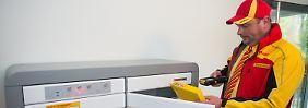 DHL-Paketkasten für Mehrfamilienhäuser in einer Berliner Wohnanlage.