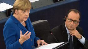 Symbolträchtiger Auftritt: Merkel und Hollande warnen vor nationaler Abschottung