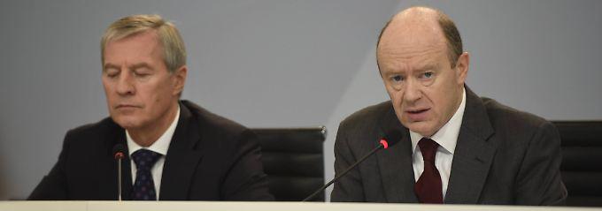 200 Filialen und 4000 Arbeitsplätze in Deutschland auf der Streichliste: John Cryans (r.) erster Auftritt als Chef der Deutschen Bank.