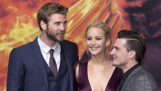 """Liam Hemsworth (l.), Jennifer Lawrence und Josh Hutcherson bei der Premiere des letzten """"Panem""""-Teils."""