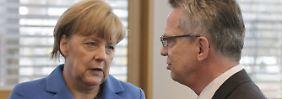 Dublin-Entscheidung de Maizières: Merkel wusste nichts