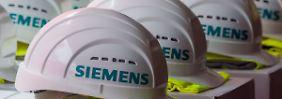 Spartenverkauf und Sonderkosten: Dunkler Gruß belastet Siemens-Gewinn