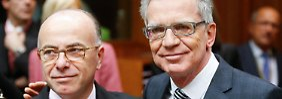 Die Innenminister von Frankreich, Bernard Cazeneuve (l.), und Deutschland, Thomas de Maizière, bei dem Treffen in Brüssel.
