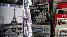 """Ein Jahr nach dem Anschlag: """"Charlie Hebdo""""-Sonderheft zeigt Gott als Terrorist"""