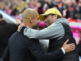 Bald wieder vereint, allerdings in England statt Deutschland: Guardiola und Ex-BVB-Coach Jürgen Klopp, jetzt beim FC Liverpool tätig.