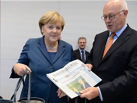 CSU-Mann Uhl mit Kanzlerin Merkel.