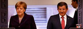 Türkei bekommt eine neue Bühne: Grimmige Merkel lässt Davutoğlu grinsen