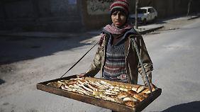 Jugendlicher Straßenhändler in Damaskus