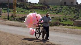 Zuckerwatte im Kriegsgebiet: Die Waffenruhe ist ein erster Hoffnungsschimmer für das bürgerkriegsgebeutelte Land.