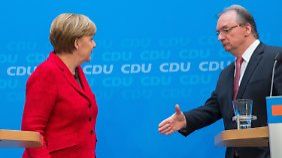 Merkel und Gabriel beschwichtigen: Auf Wahlsieger wartet schwierige Koalitionsbildung
