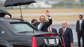 Mit strömendem Regen begrüßt Kuba Obama.