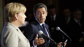 Angela Merkel unterstützt Nicolas Sarkozy.