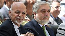 Partner wider Willen: Aschraf Ghani (links) und Abdullah Abdullah.