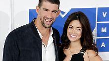 Michael Phelps und Nicole Johnson sind Eltern eines kleinen Jungen. Foto: Jason Szenes